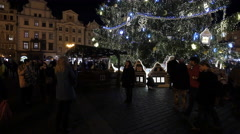 People eating near the Christmas tree in the Old Town Square, Prague Stock Footage