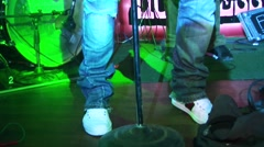 Dima Bilan perform on stage of nightclub. Microphone stand. Pan vertical Stock Footage