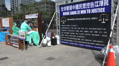Taiwan protest, Falun Gong, arrest Jiang Zemin, sign petition, human rights Stock Footage