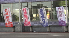 People walk past political banners calling for an independent Taiwan, in Taipei Stock Footage