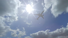 Distant Boing 787 flying across beautiful cloudy sky. 4K sunny weather pan video Stock Footage