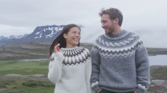 Happy young couple laughing outside in nature playful having fun together Stock Footage