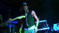 Dima Bilan perform with band on stage of nightclub. Gold mic. Zoom in. Dance Stock Footage