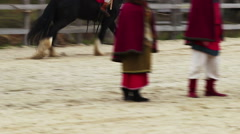 The medieval festival of horse riding. Riders mastery of impressive horse tricks - stock footage