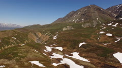 Aerial Flying Over Rugged Mountain Terrain and Ravine 4K Stock Footage