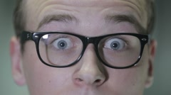 Surprised guy in glasses - stock footage