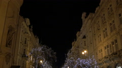 Night view of Parizska street with decorated trees in Prague Stock Footage