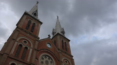 Time lapse, clouds move over Notre Dame Cathedral in Saigon, Vietnam Stock Footage