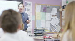 4K Young students listening to the teacher in school classroom Stock Footage