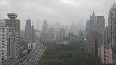 Shanghai skyline rainy weather storm wind flying clouds time lapse China Stock Footage