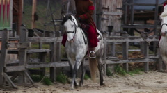 Ancient riders on purebred horses organizing competition on the main street Stock Footage