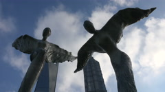 Shanghai central business financial district, angel statues, clouds time lapse Stock Footage