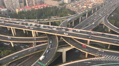 Traffic drives over a busy elevated highway in Shanghai, time lapse video Stock Footage