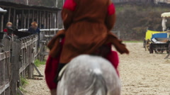 Riders on pedigreed horses arrive in medieval town. Historical reenactment Stock Footage