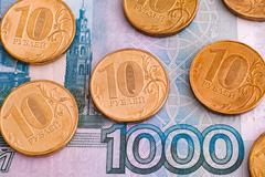 Ruble coins on one thousand rubles banknote Stock Photos