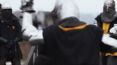 The unpredictable battle between two knights in heavy armor steel. Middle Ages Stock Footage