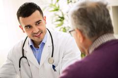 Old man visit doctor, patient care Stock Photos