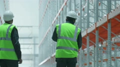 workers in overalls come in modern warehouse - stock footage
