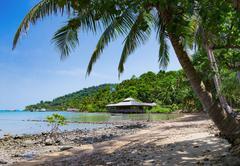 Tropical beach on the island - stock photo