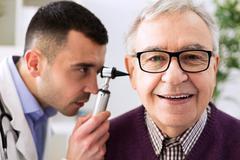 Senior patient visit otologist Stock Photos