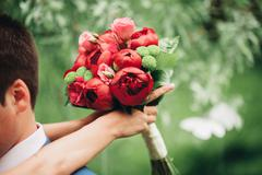 Wonderful luxury wedding bouquet of different flowers Stock Photos