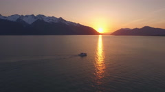 Motor Boat Cruising Past Sunset Reflection Alaska Sunbeam on Water 4 Stock Footage