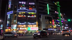 Bright lights of the Gwanganhaebyeon road along the Gwangalli Beach at night Stock Footage