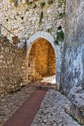 Arched entrance to the historic city Eze - stock photo