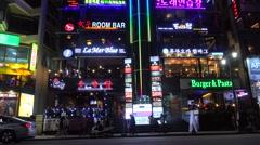 Bright lights of the Gwanganhaebyeon road along the Gwangalli Beach at night Stock Footage