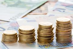 Stock Photo of Euro coins on banknote money background