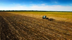 Aerial view of tractor plowing the soil Stock Footage