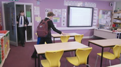 4K Young students entering school classroom before a lesson. Stock Footage