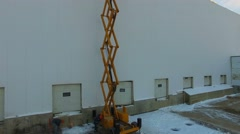 Aerial view of workers on roof of warehouse Stock Footage