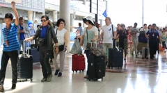 Passengers arrive at check-in counters International Airport. Bangkok, Thailand Stock Footage