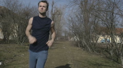 Young athlete jogging in an abandoned place - stock footage