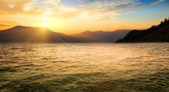 Sea and high mountains - stock photo