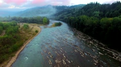 Aerial view of the mountain river in Carpathians on sunrise - stock footage