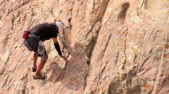 Climber practicing in a face of the Bernal rock. Stock Footage