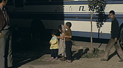Iran 1973: children in front of a tourist bus Stock Footage