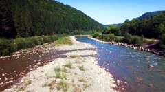 Aerial view of the mountain river in Carpathians - stock footage