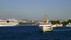 Passenger ship and a luxury cruise ship maneuvering out of port during vist Stock Footage