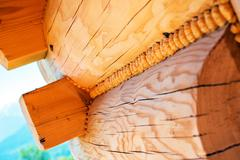 Log Homes Technology. Wood Logs Attachment Log Home Construction Theme. - stock photo