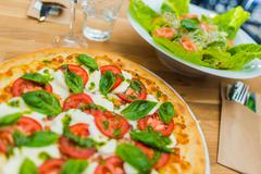 Margarita Pizza Time. Tasty Italian Lunch. - stock photo