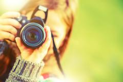 Photography Hobby. Girl with Modern Digital Interchangeable Lenses - stock photo