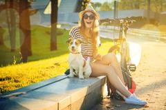 Happy Hipster Girl with her Dog in the City Stock Photos