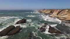 Pt Arena Cliffs to Lighthouse LS  Rocks and Sea Aerial 4K Stock Footage