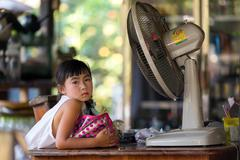 Serious Thai little girl - stock photo