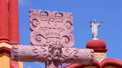 Cross and statue of the Bernal church. Stock Footage
