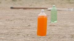 Slow Motion Soda Bottle Explodes After Shot Stock Footage