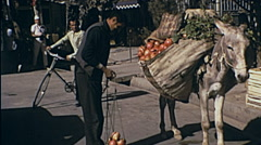 Shiraz, Iran 1973: man selling fruit in the street Stock Footage